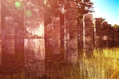 Ancient stone columns in Chichen Itza. Famous archaeological complex in Mexico. Ancient stone columns in Chichen Itza. Famous archaeological complex in Mexico stock photo