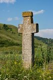 Ancient stone cross Stock Photography