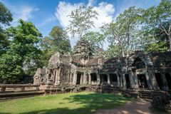 Ancient stone door with clear blue sky, Ta Prohm temple ruins, A. View of an ancient stone door with clear blue sky, Ta Prohm temple ruins, Angkor, Cambodia stock image