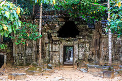 Ruins of ancient buddhist khmer temple. Ancient stone door in ruins of  buddhist khmer temple near Siem Reap, Cambodia Royalty Free Stock Photos