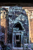 Ruins of ancient buddhist khmer temple. Ancient stone door in ruins of  buddhist khmer temple near Siem Reap, Cambodia Royalty Free Stock Photography