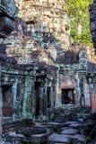 Ruins of ancient buddhist khmer temple near. Ancient stone door in ruins of  buddhist khmer temple near Siem Reap, Cambodia Stock Photos