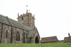 Ancient stone English Church against bright grey sky stock photos