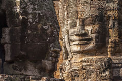 Ancient stone face of Bayon temple Stock Photo