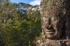 Ancient stone face of Bayon temple Royalty Free Stock Image