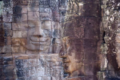 Ancient stone face of Bayon temple Royalty Free Stock Photos
