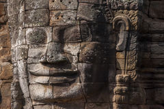Ancient stone face of Bayon temple Stock Image