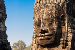 Ancient stone smiling face of the Prasat Bayon Wat temple in the jungle, Angkor wat, Cambodia. Angkor Wat isthe largest Stock Photos