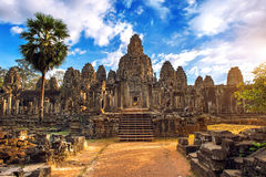 Free Ancient Stone Faces At Sunset Of Bayon Temple, Angkor Wat. Stock Image - 91010821
