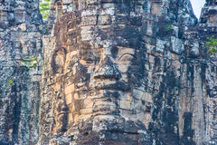 Ancient stone faces of Bayon temple, Angkor, Cambodia Stock Photos