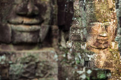 Ancient stone faces of Bayon temple, Angkor, Cambodia Stock Images