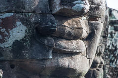 Ancient stone faces of Bayon temple, Angkor, Cambodia Royalty Free Stock Photo