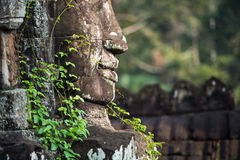 Ancient stone faces of Bayon temple, Angkor, Cambodia Royalty Free Stock Images