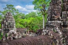 Ancient stone faces of Bayon temple, Angkor, Cambodia Royalty Free Stock Image
