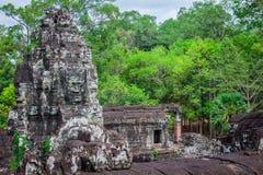 Ancient stone faces of Bayon temple, Angkor, Cambodia Royalty Free Stock Images