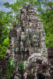 Ancient stone faces of Bayon temple, Angkor, Cambodia Stock Photos