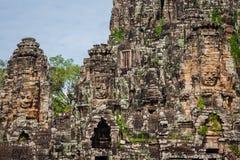 Ancient stone faces of Bayon temple, Angkor, Cambodia Royalty Free Stock Photos