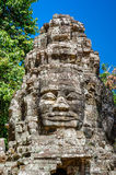 Ancient stone faces Bayon temple in Angkor Thom Royalty Free Stock Photos