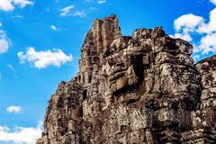 Ancient stone faces of Bayon temple, Angkor Wat, Siam Reap. Royalty Free Stock Photography