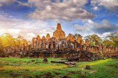 Ancient stone faces of Bayon temple, Angkor Wat, Siam Reap. Royalty Free Stock Photo