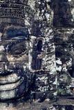 Ancient stone faces of Bayon temple, Angkor Wat, Siam Reap. Royalty Free Stock Image