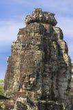 Ancient stone faces of king Jayavarman VII at The Bayon temple, Royalty Free Stock Photo