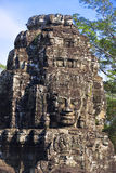 Ancient stone faces of king Jayavarman VII at The Bayon temple, Stock Photos