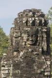 Ancient stone faces of king Jayavarman VII at The Bayon temple, Royalty Free Stock Photography