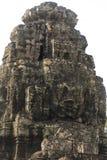 Ancient stone faces of king Jayavarman VII at The Bayon temple, Stock Photo
