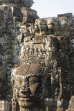 Ancient stone faces of king Jayavarman VII at The Bayon temple, Royalty Free Stock Photography