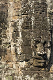Ancient stone faces of king Jayavarman VII at The Bayon temple, Stock Photography