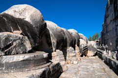 Ancient stone fallen columns at the Apollo ruins, Didyam. Royalty Free Stock Images