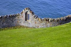 Ancient stone fencing. By the ocean in Ireland Stock Photography