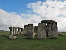 The ancient stone formation at Stonehenge. Stonehenge is an ancient stone circle in the heart of Wiltshire that predates written records. It is a major tourist stock photo