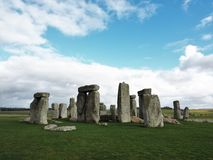 The ancient stone formation at Stonehenge. Stonehenge is an ancient stone circle in the heart of Wiltshire that predates written records. It is a major tourist royalty free stock photo