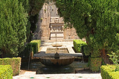 Ancient stone fountain in Alhambra Gardens, Granada, Spain stock photography
