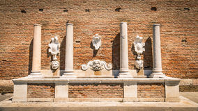 Ancient stone fountain depicting the god Neptune and other roman Royalty Free Stock Photos