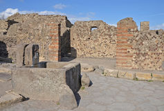 Ancient stone fountain at the end of the street, Pompeii. Italy. Built as a source of drinking water stock photos