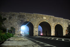 Ancient stone gate of city. In night Royalty Free Stock Photography