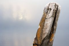 Ancient stone idol misty morning Royalty Free Stock Images
