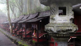 Ancient stone lantern in the fog.The temple complex Mitsumine. Japan. Chichibu. Saitama stock footage