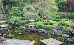 Ancient stone lantern in Japanese park Royalty Free Stock Photos