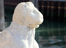 Ancient stone lion statue at the gates of Arsenal, Venice, Italy stock images