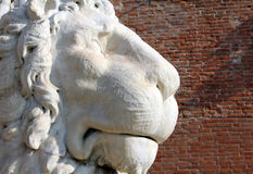 Ancient stone lion statue at the gates of Arsenal, Venice, Italy stock image