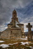 Ancient stone monastery. Building in bleak winter Royalty Free Stock Photography