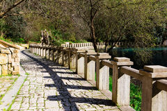 Ancient stone promenade with stone railing. In New Athos Abkhazia Stock Images