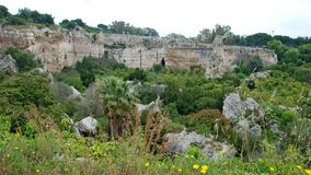 Ancient stone quarry at the archaeologic park of Syracuse Stock Photography