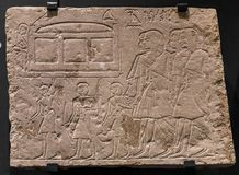 Ancient stone relief at Chnum temple in Egypt.  Stock Photos