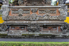Ancient stone reliefs in balinese temple Stock Photo