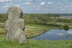 ancient stone religious cross on a hill in background of the river Royalty Free Stock Image